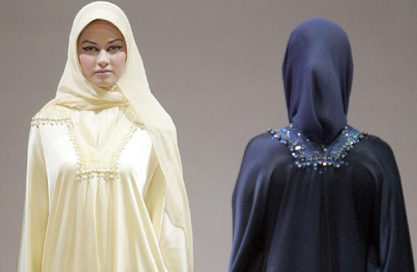 Models display a creation by designer Saiful during Islamic Fashion Festival in Kuala Lumpur